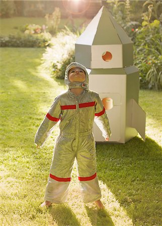 spaceship - Boy Wearing Space Suit Standing in front of Cardboard Rocket Spacecraft Stock Photo - Rights-Managed, Code: 822-06302729