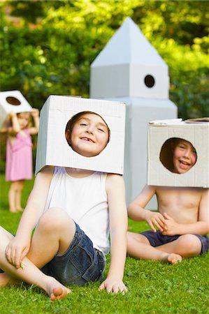 Boys Wearing Homemade Cardboard Helmets Stock Photo - Rights-Managed, Code: 822-06302721