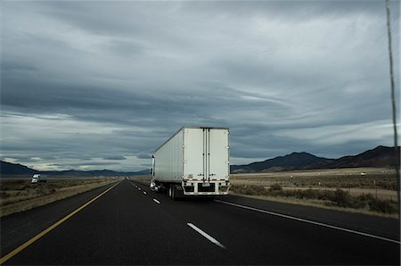 Trucks Driving on Motorway Stock Photo - Rights-Managed, Code: 822-06302736