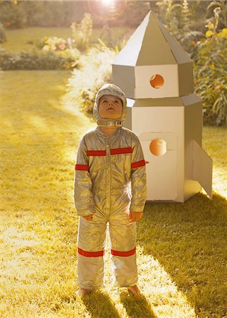 spaceship - Boy Wearing Space Suit Standing in front of Cardboard Rocket Spacecraft Stock Photo - Rights-Managed, Code: 822-06302730