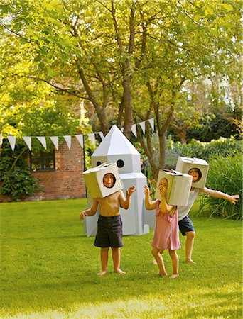 dress up girl - Children Wearing Homemade Cardboard Helmets Playing around Rocket Spacecraft Stock Photo - Rights-Managed, Code: 822-06302765