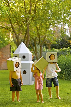 dress up girl - Children Wearing Homemade Cardboard Helmets Playing around Rocket Spacecraft Stock Photo - Rights-Managed, Code: 822-06302782