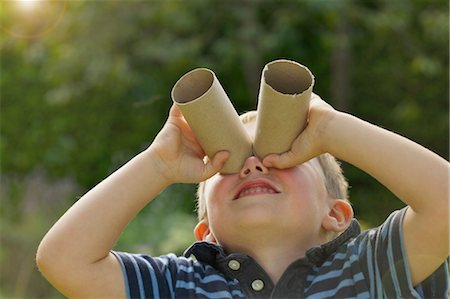 funny looking people - Young Boy Looking Through Empty Toilet Paper Rolls Stock Photo - Rights-Managed, Code: 822-06302798