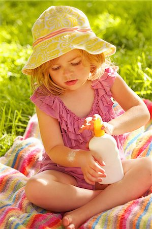 Young Girl Applying Suntan Lotion on Arm Stock Photo - Rights-Managed, Code: 822-06302817