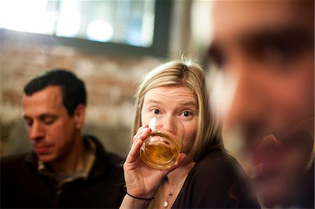 Woman Drinking in Bar with Friends Stock Photo - Rights-Managed, Code: 822-06702161