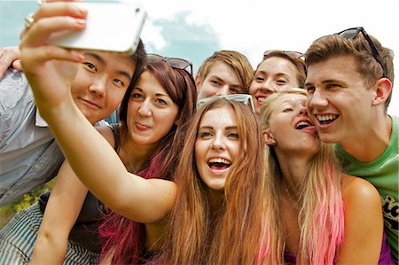 Group of Teenagers Taking Self Portrait Photo at Music Festival Stock Photo - Rights-Managed, Code: 822-06702199