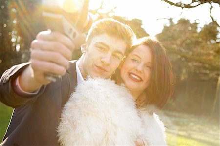 Young Couple Making Video of themselves Stock Photo - Rights-Managed, Code: 822-06702206