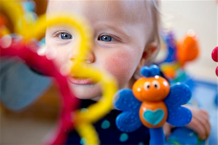 domestic life - Baby Girl Playing with Colourful Toys Stock Photo - Rights-Managed, Code: 822-06702209