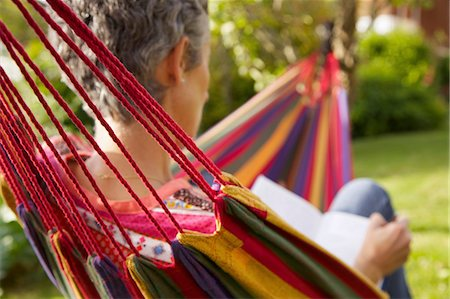 Back View of Woman on Hammock Reading Stock Photo - Rights-Managed, Code: 822-06702218
