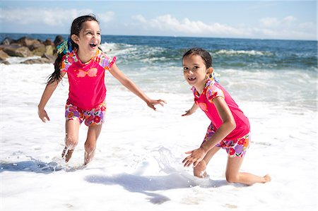 Twin Girls in Matching Outfits Playing on Beach Stock Photo - Rights-Managed, Code: 822-06702211