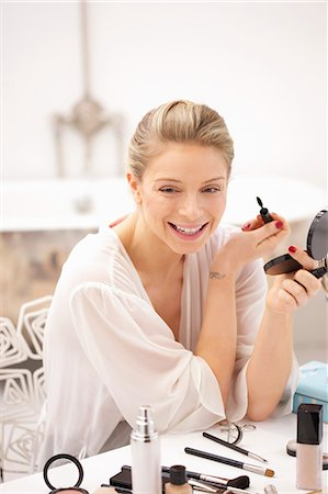 personal care - Woman at Dressing Table Applying Mascara Stock Photo - Rights-Managed, Code: 822-06702225