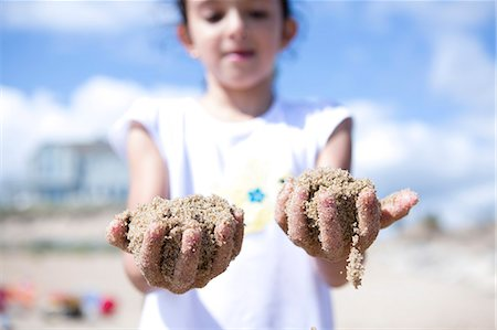 fingers holding - Girl with Hands Full of Sand Stock Photo - Rights-Managed, Code: 822-06702235