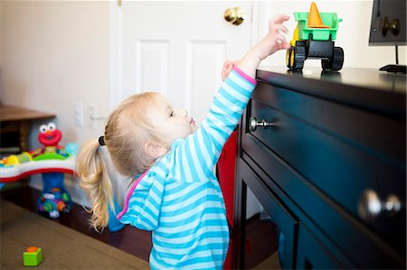 Girl Reaching for Toy Stock Photo - Rights-Managed, Code: 822-06702246