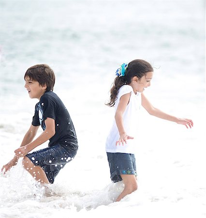 Boy and Girl Playing in Sea Water Stock Photo - Rights-Managed, Code: 822-06702251