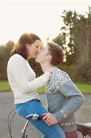Young Couple Kissing on Bicycle Stock Photo - Rights-Managed, Code: 822-06702265