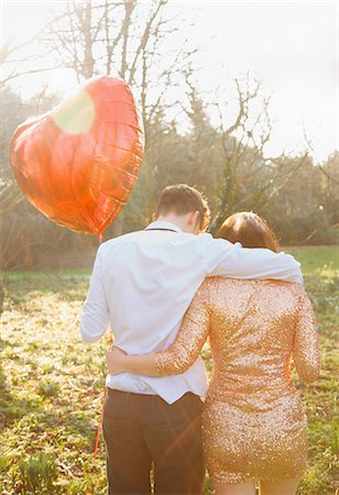 Couple in Park Holding Heart Shaped Balloon, Back View Stock Photo - Rights-Managed, Code: 822-06702266