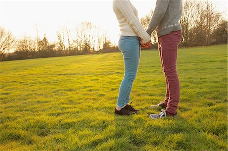 Young Couple Holding Hands in Field, Low Section Stock Photo - Rights-Managed, Code: 822-06702298