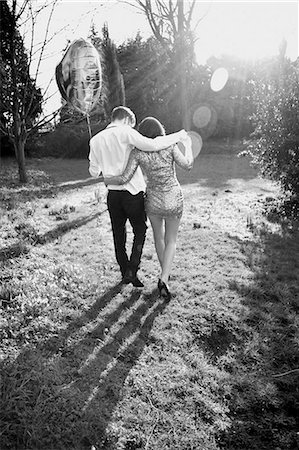 Couple in Park Holding Heart Shaped Balloon, Back View Stock Photo - Rights-Managed, Code: 822-06702299