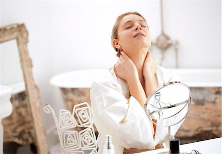 Woman at Dressing Table Rubbing her Neck Stock Photo - Rights-Managed, Code: 822-06702302