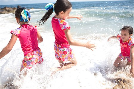 families playing on the beach - Girls in Matching Outfit Playing in Sea Water Stock Photo - Rights-Managed, Code: 822-06702326