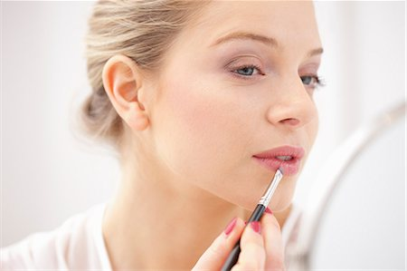personal care - Woman Applying Lipstick with Makeup Brush Stock Photo - Rights-Managed, Code: 822-06702339