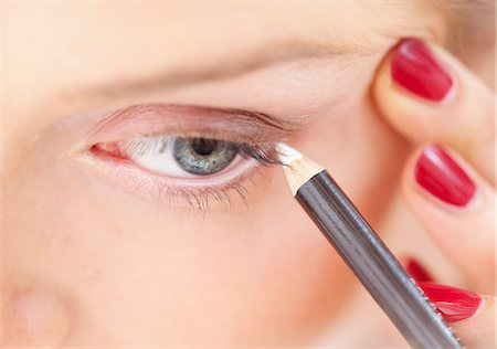 personal care - Close-up View of Woman Using Eye Pencil Stock Photo - Rights-Managed, Code: 822-06702340