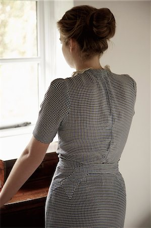 Back View of Woman Looking Out of Window Stock Photo - Rights-Managed, Code: 822-06702354