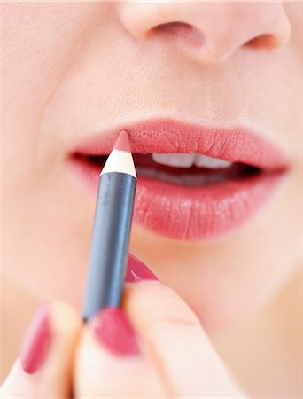 Close-up View of Woman Using Lip Pencil Stock Photo - Rights-Managed, Code: 822-06702388