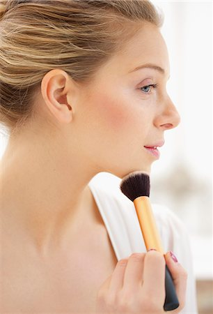 personal care - Woman Applying Blusher on Chin Stock Photo - Rights-Managed, Code: 822-06702389