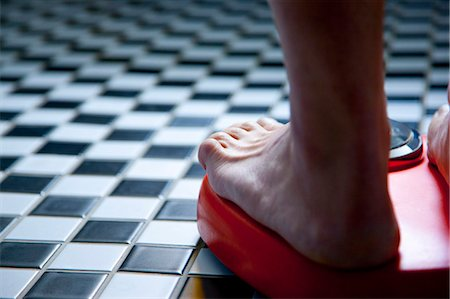 Close up of Feet on Weighing Scale Stock Photo - Rights-Managed, Code: 822-06702397