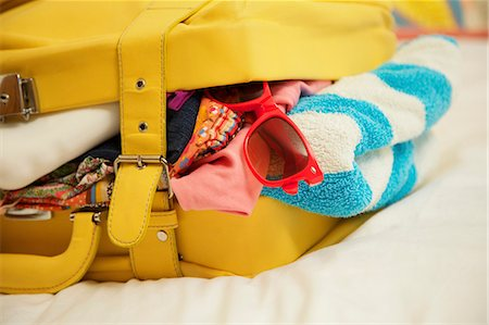 Yellow Suitcase Bursting with Clothing Stock Photo - Rights-Managed, Code: 822-06702391