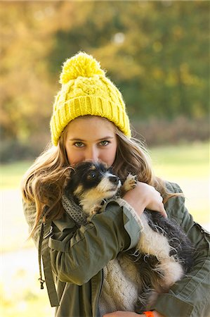 dog and woman and love - Teenage Girl Hugging Puppy Outdoors Stock Photo - Rights-Managed, Code: 822-06702412