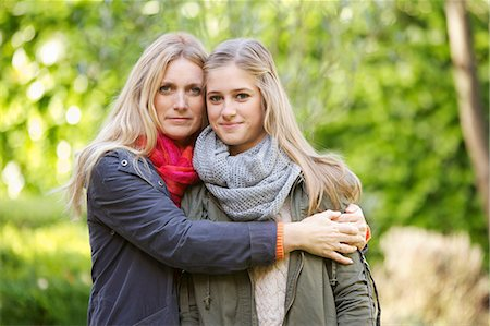 daughter middle-aged mother women young adults - Mother Hugging Daughter Outdoors Stock Photo - Rights-Managed, Code: 822-06702423