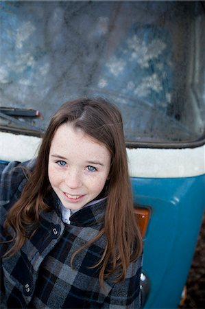 Girl Standing in front of Vehicle Smiling Stock Photo - Rights-Managed, Code: 822-06702433