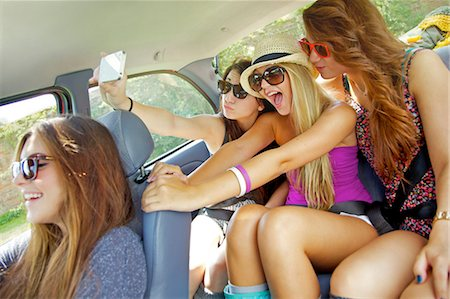Teenage Girls Taking Self Portrait Photo Inside Car Stock Photo - Rights-Managed, Code: 822-06702456