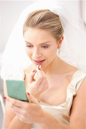 Bride Applying Lipstick Stock Photo - Rights-Managed, Code: 822-06702451