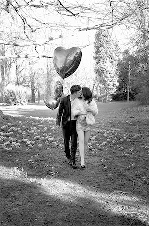 Young Couple Kissing in Park Holding Heart Shaped Balloons Stock Photo - Rights-Managed, Code: 822-06702464
