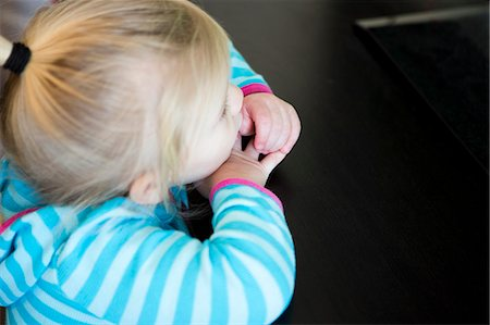 sucking - Girl Resting Head on Table Stock Photo - Rights-Managed, Code: 822-06702472