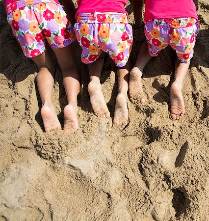 sole - Back View of Girls in Matching Outfit Kneeling on Sand, Cropped Stock Photo - Rights-Managed, Code: 822-06702491