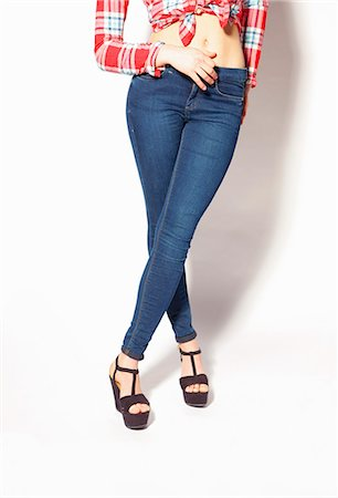 Woman in Skin-tight Jeans, Low Section Stock Photo - Rights-Managed, Code: 822-06702512