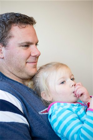 sucking - Girl Sucking Thumb on Father Lap Stock Photo - Rights-Managed, Code: 822-06702534
