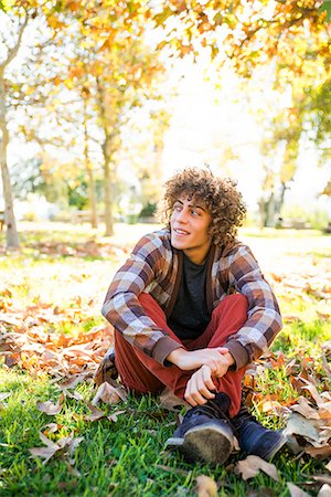Young Man Sitting in Park in Autumn Stock Photo - Rights-Managed, Code: 822-06702537