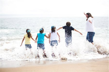Back View of Family Running into the Sea Stock Photo - Rights-Managed, Code: 822-06702561