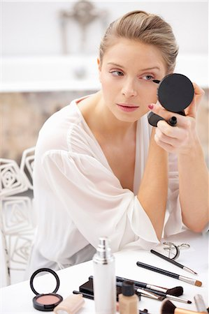personal care - Woman at Dressing Table Applying Mascara Stock Photo - Rights-Managed, Code: 822-06702563