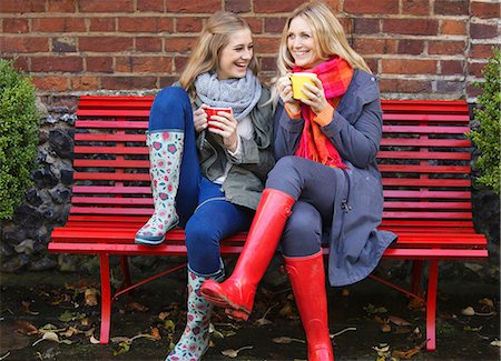people sitting on bench - Mother and Daughter Sitting on Red Bench with Hot Drinks Stock Photo - Rights-Managed, Code: 822-06702574