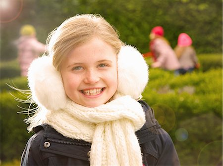 Smiling Young Girl Wearing Earmuffs Stock Photo - Rights-Managed, Code: 822-07117404