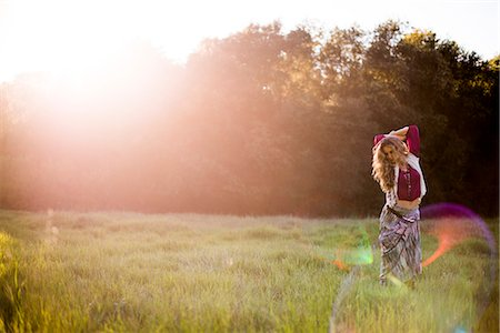 Woman Standing in Field Stock Photo - Rights-Managed, Code: 822-07117415