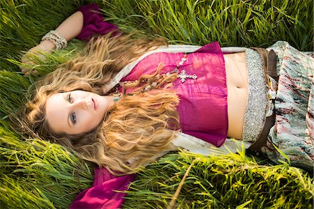 Woman Lying in Long Grass Stock Photo - Rights-Managed, Code: 822-07117416