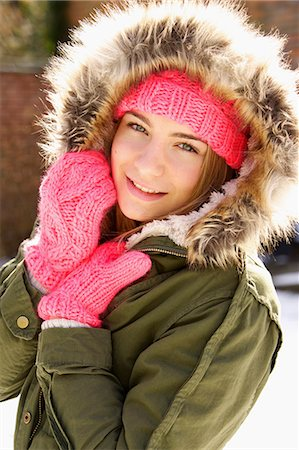 Smiling Teenage Girl Wearing Hooded Parka Outdoors Stock Photo - Rights-Managed, Code: 822-07117419