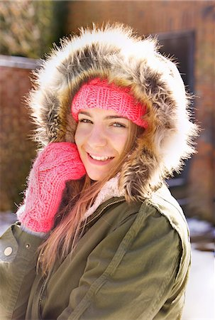 Smiling Teenage Girl Wearing Hooded Parka Outdoors Stock Photo - Rights-Managed, Code: 822-07117420